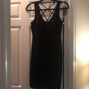 Crossed knee length black dress